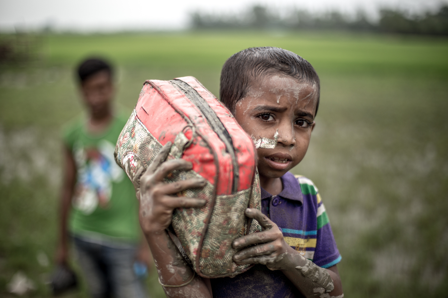 In Cox's Bazar, Bangladesh, tens of thousands of refugees flee over the border from Burma.
