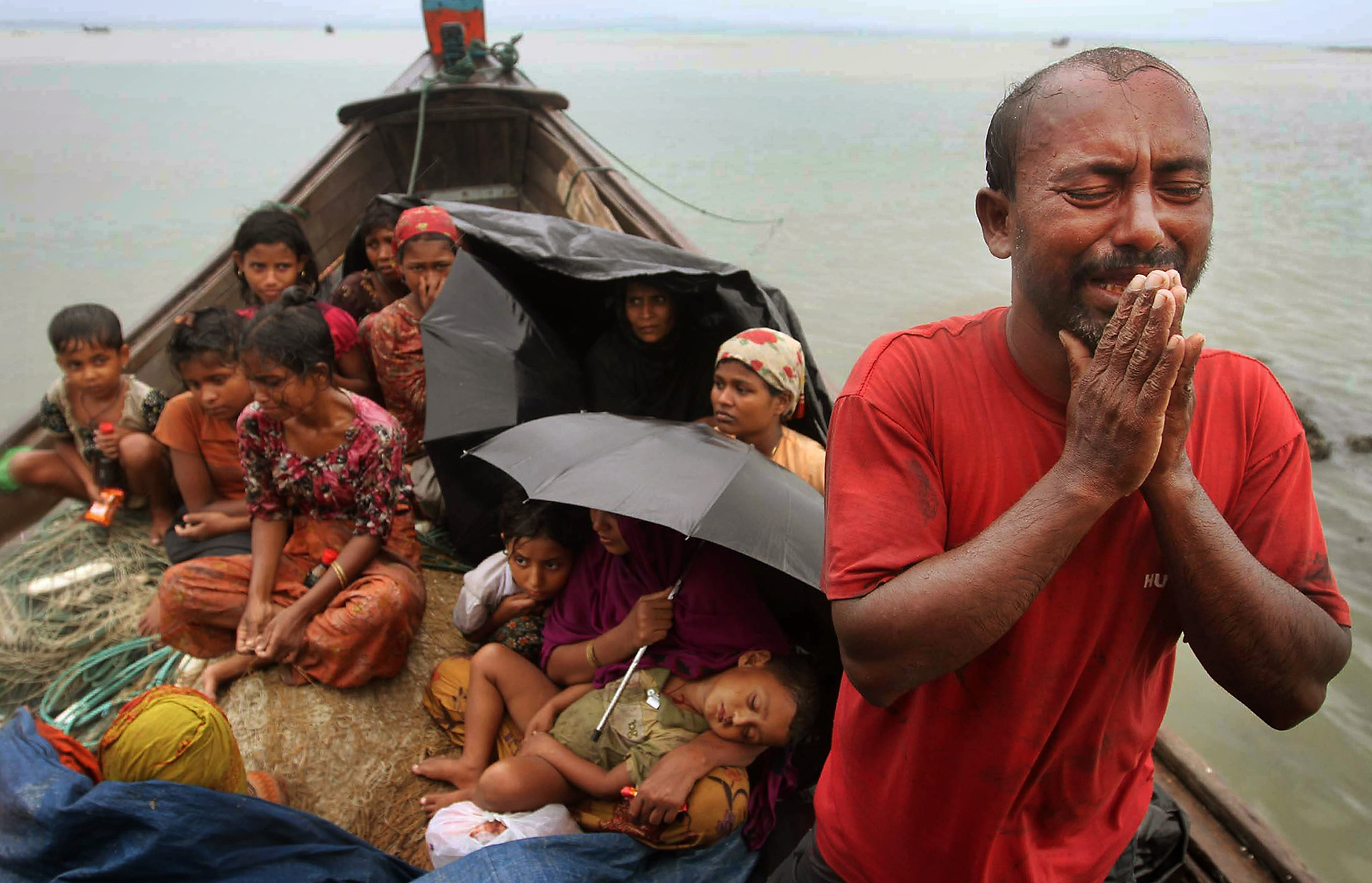 FILE - In this June 13, 2012 file photo, a Rohingya Muslim man who fled Myanmar to Bangladesh to escape religious violence, cries as he pleads from a boat after he and others were intercepted by Bangladeshi border authorities in Taknaf, Bangladesh. She is known as the voice of Myanmar's downtrodden but there is one oppressed group that Aung San Suu Kyi does not want to discuss. For weeks, Suu Kyi has dodged questions on the plight of a Muslim minority known as the Rohingya, prompting rare criticism of the woman whose struggle for democracy and human rights in Myanmar have earned her a Nobel Peace Prize, and adoration worldwide. (AP Photo/Anurup Titu, File)